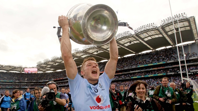 Paul Flynn lifts the Sam Maguire Cup in front of Hill 16