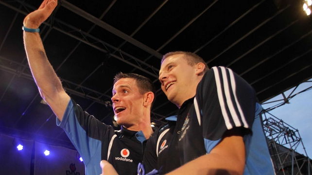 Stephen Cluxton and Tomás Quinn wave to the crowd