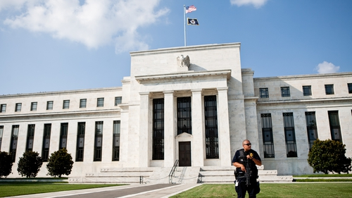 "The Fed said interest rates would remain near zero ""for a considerable time"" after the bond buying ends"