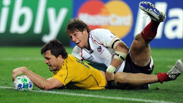 Wallabies wing Adam Ashley-Cooper scores a try infront of US full back Blaine Scully