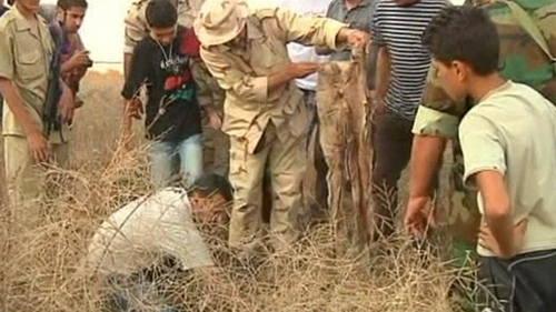 Mass grave linked to Muammar Gaddafi