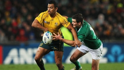 Jonathan Sexton tackles Kurtley Beale of Australia