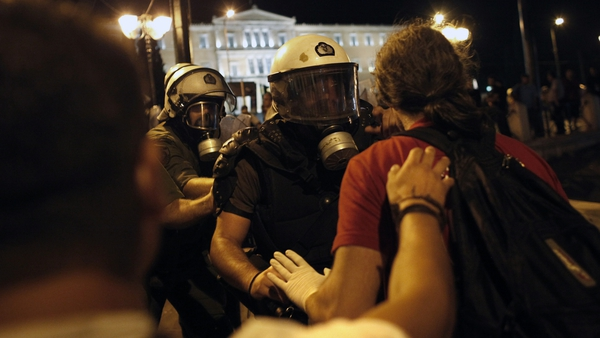 Protesters fight with riot police during clashes at the central Athens Syntagma square last night