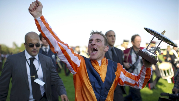 Andrasch Starke celebrates riding Danedream to victory in the Arc