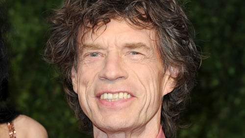 Mick Jagger is all smiles about his upcoming photo book