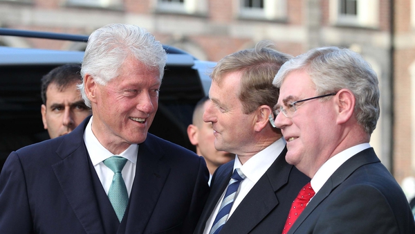 Bill Clinton greeted by the Taoiseach and the Tánaiste
