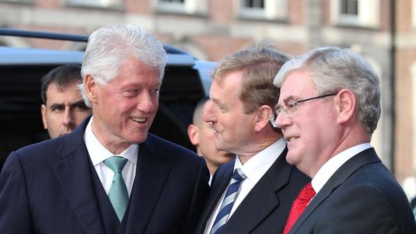 Bill Clinton greeted by the Taoiseach and the Tánaiste