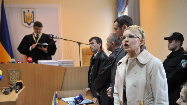 Yulia Tymoshenko speaks to reporters as the judge reads his judgment