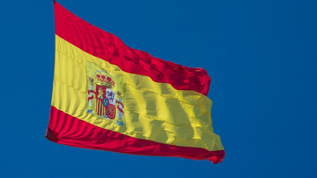 "Spain says downgrade ""contradictory"""