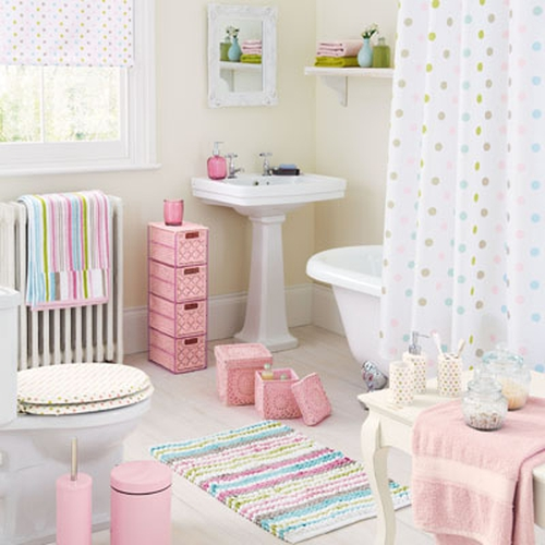 NEXT: Blind €26, Mirror €45, Towels from €4.50, Recycled Glass Accessory set €21, Storage Drawer €51, Vintage Stripe Towel €10, Storage Basket (2-set) €26, Pedal Bin €10, Toilet Brush €9, Toilet Seat €39, Spot Accessory Set €18, Glass Storage Jars €7.50,