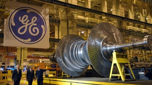 GE's first quarter earnings were held back by the drag from the strong dollar
