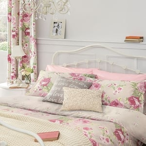 Curtain from €45, Chandelier €116, Lamp €32, Victoria bedstead from €350, Bedset from €32, Vintage Pink Pillowcases €10, Love Cushion €18, Flower Cushion €21, Chunky Knit Throw €51