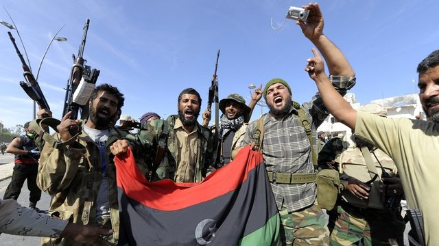 NTC soldiers celebrate the demise of the former LIbyan leader