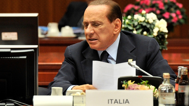 Berlusconi facing pressure to quit