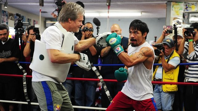 Manny Pacquiao (R) works out with trainer Freddie Roach at Wildcard Boxing Club in Hollywood yesterday