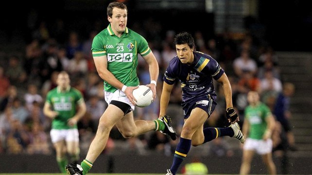 Michael Murphy of Ireland evades Australia's Angus Monfries