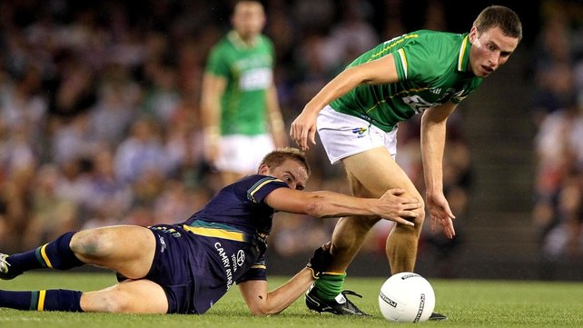 Paddy Kelly of Ireland finds Bernie Vince a tenacious opponent