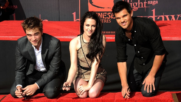 The young Twilight stars have their moment outside Grauman's Chinese Theatre.