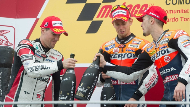 (Left to right) Ben Spies of Yamaha Factory Racing; Casey Stoner of Repsol Honda Team; and Andrea Dovizioso of Repsol Honda Team celebrate on the podium at the end of the MotoGP race in Valencia