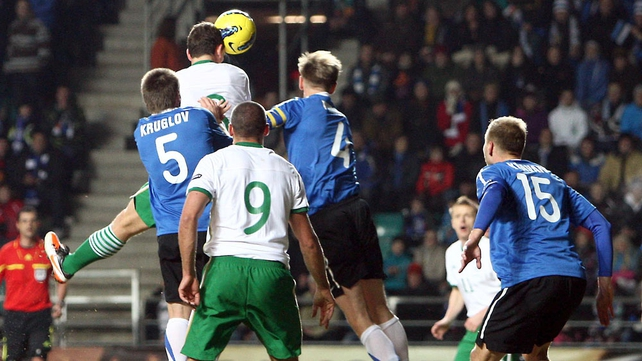 Keith Andrews gets above the Estonian defence...