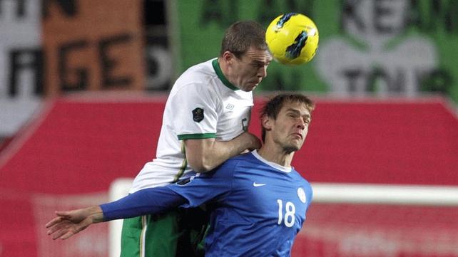 Richard Dunne clears the ball