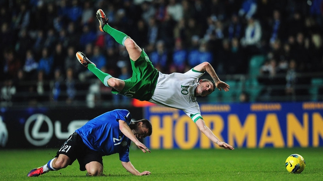 Robbie Keane is upended by the previously booked Andrei Stepanov...