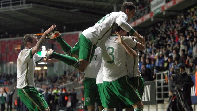The players celebrate the Irish captain's 52nd international goal
