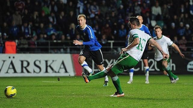 Robbie Keane strikes the penalty...