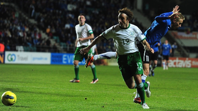 Stephen Hunt is brought down for a penalty as Estonia fall apart