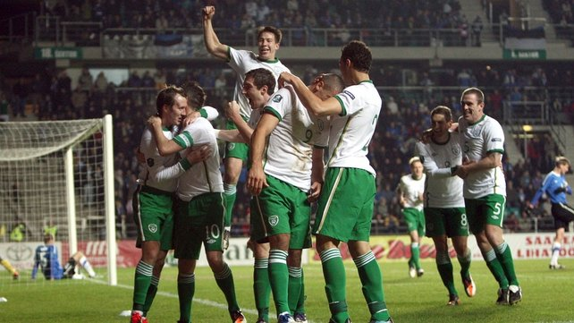 ...and the players celebrate Walters' first goal for his country