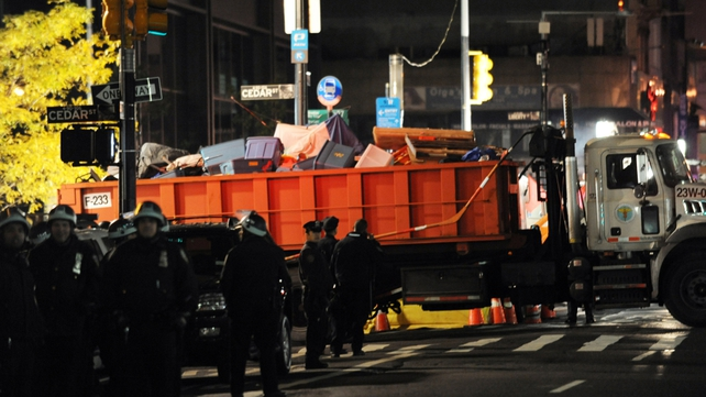 Sanitation workers clear the debris from Zuccotti Park