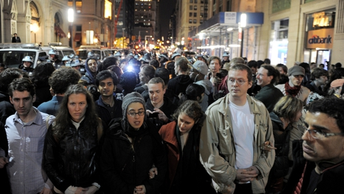 People link arms a few blocks from Zuccotti Park as New York City officials clear the 'Occupy Wall Street' protest