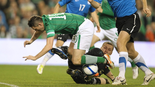 Robbie Keane is denied by the legs of the Estonian goalkeeper