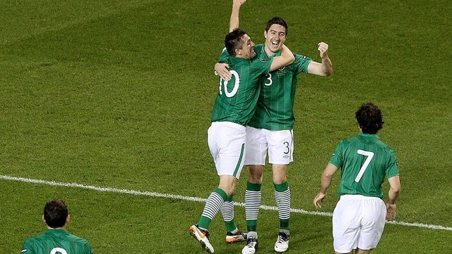 ...and is congratulated by skipper Robbie Keane