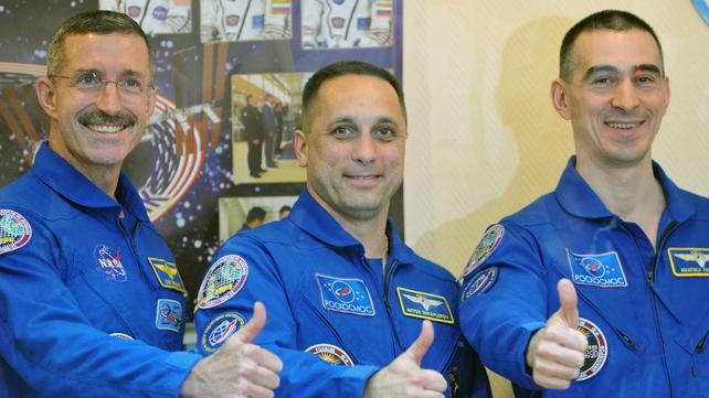 Dan Burbank, Anton Shkaplerov and Anatoly Ivanishin before they launched off