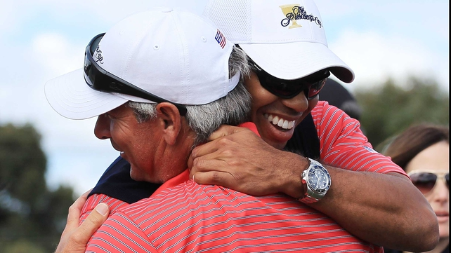Tiger Woods and Fred Couples embrace after the US sealed victory in the Presidents Cup