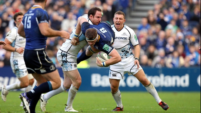 Jamie Heaslip of Leinster keeps possession while tackled by Glasgow's Graeme Morrison