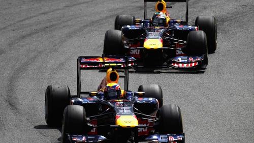 Mark Webber and Sebastian Vettel - Webber passes his team-mate during the race (above)