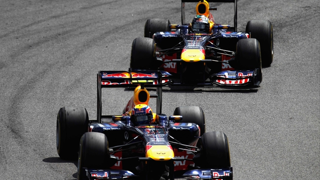 Mark Webber and Sebastian Vettel - Webber passes his team-mate during the race (above)