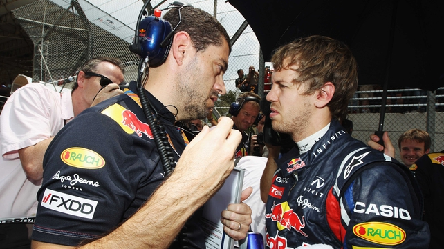 Team effort - Sebastian Vettel (r) with race engineer Guillaume Rocquelin