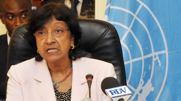 Navi Pillay said she was concerned about violations by anti-government forces