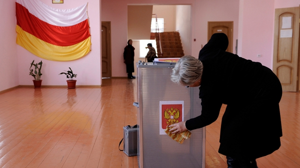 A member of a local election commission prepares a polling station in Tskhinvali