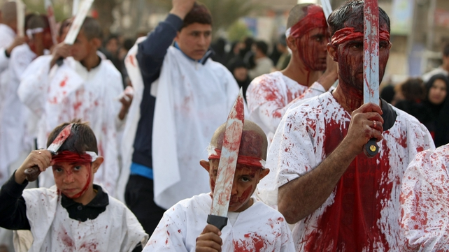 Bloodied Iraqi Shias use knives in a self-flagellation ritual in Baghdad during Ashura commemorations