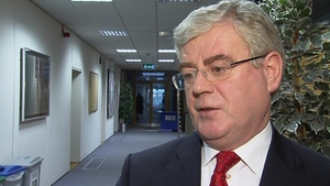 Eamon Gilmore said the Government will decide how the promissory note deal savings are used