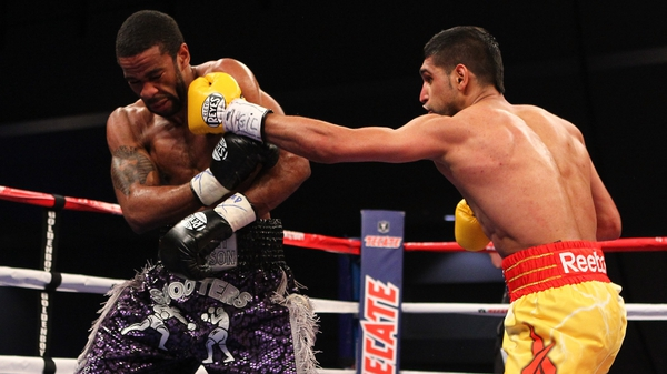 Amir Khan has called Lamont Peterson a 'cheat' and is seeking the return of the WBA and IBF titles