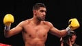 Khan confirms July bout with Garcia