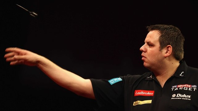 Adrian Lewis has scraped to victory on the opening night of the PDC World Championships