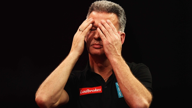 Frustrated - the partisan crowd appeared to get to Magnus Caris, who threw away a winning opportunity against Steve Beaton