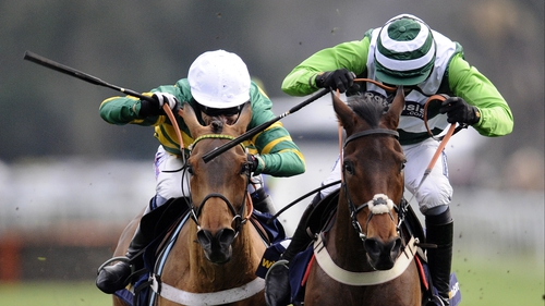 Christmas Hurdle battle - Tony McCoy and Ruby Walsh battled all the way up the home straight on Binocular (l) and Rock On Ruby (r)