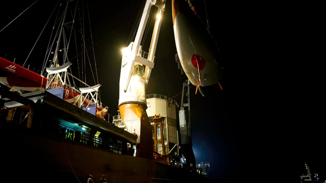 The fleet of Volvo Open 70's are lifted onto a ship